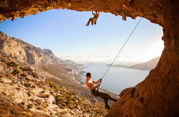 Male rock climber climbing on a roof in a cave Stock photo © photobac
