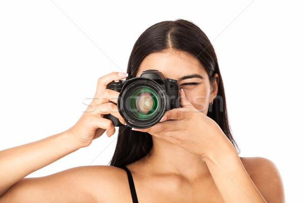 Retrato mulher jovem câmera branco Foto stock © photobac