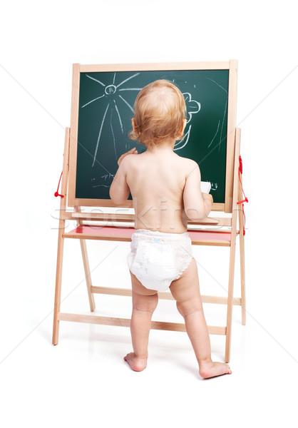 Baby boy drawing on chalkboard over white Stock photo © photobac