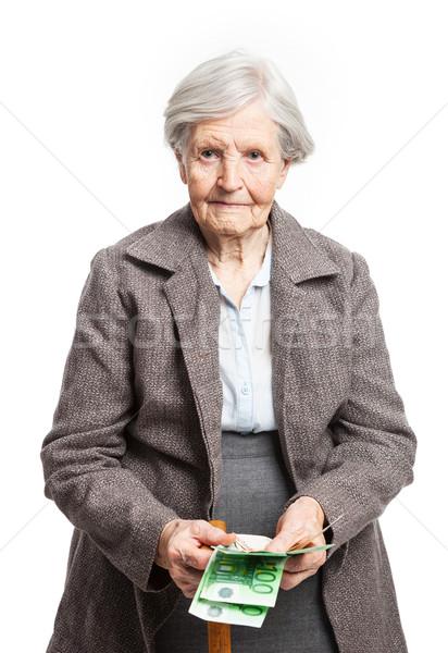 ストックフォト: シニア · 女性 · お金 · 白 · 立って · 紙