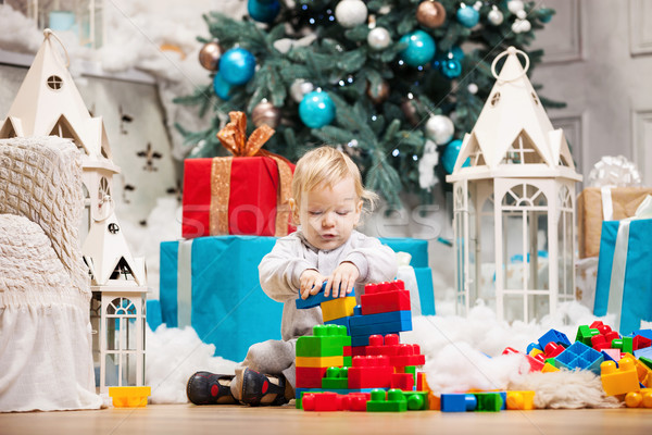Toddler boy playing with blocks at Christmas tree Stock photo © photobac