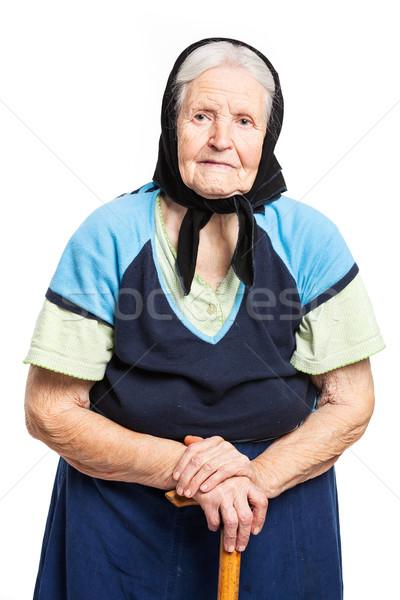 Senior mulher caminhada vara em pé branco Foto stock © photobac