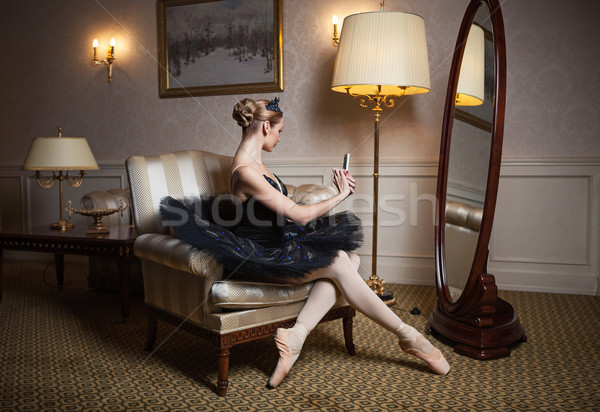 Ballerina in black tutu sitting in front of mirror Stock photo © photobac