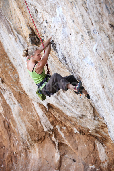 Female rock climber on a cliff face Stock photo © photobac