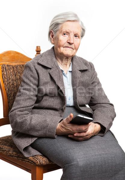 Senior mulher sessão cadeira telefone Foto stock © photobac