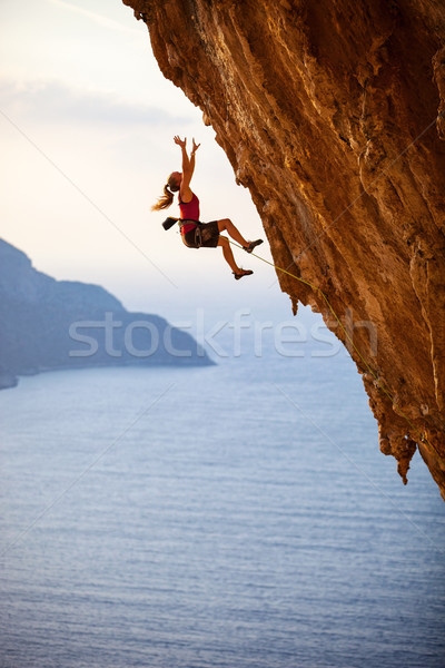 Female rock climber falling of a cliff Stock photo © photobac