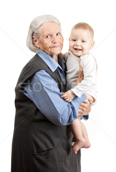 Portrait of a senior grandmother holding grandson Stock photo © photobac