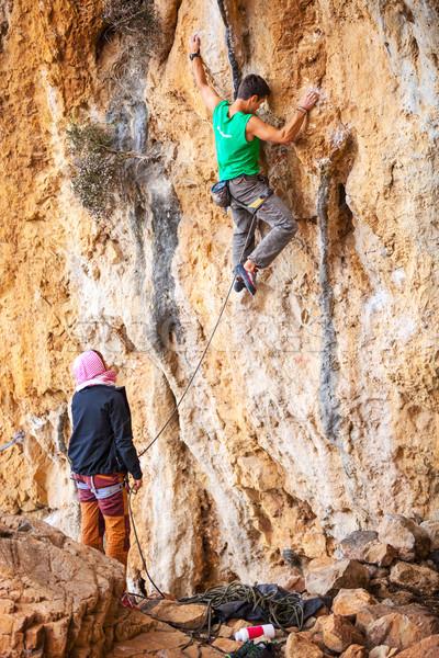Man lead climbing on cliff, belayer watching hi Stock photo © photobac
