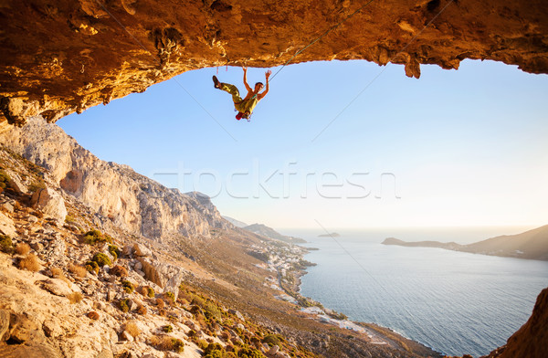Male climber has just fell of a cliff Stock photo © photobac