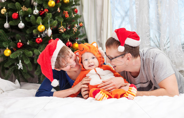 Young family with baby boy dressed in fox costume Stock photo © photobac