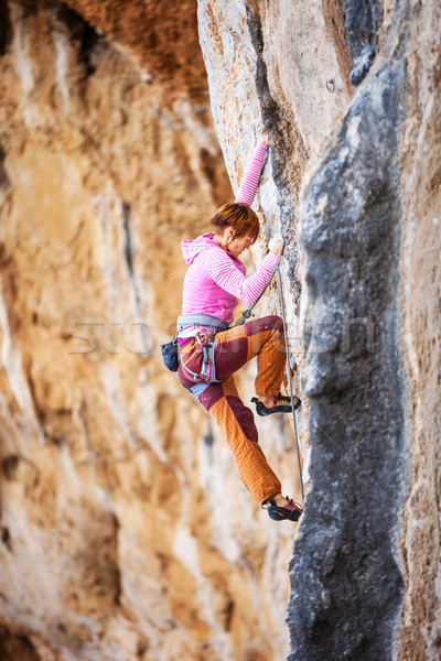 Young female rock climber on a cliff Stock photo © photobac