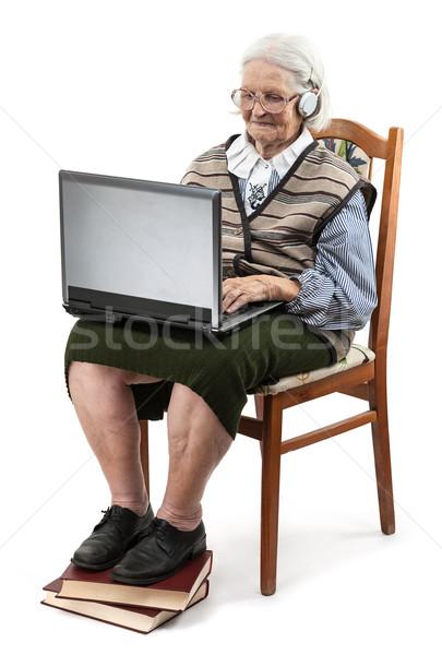 старший женщину используя ноутбук компьютер белый изолированный Сток-фото © photobac