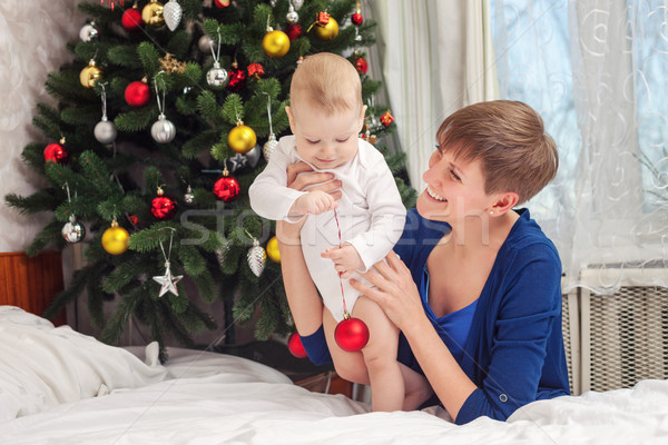 Happy mother and baby boy holding Christmas ball Stock photo © photobac