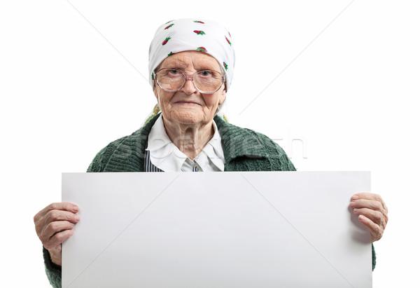 Gülen yaşlı bayan levha eller Stok fotoğraf © photobac