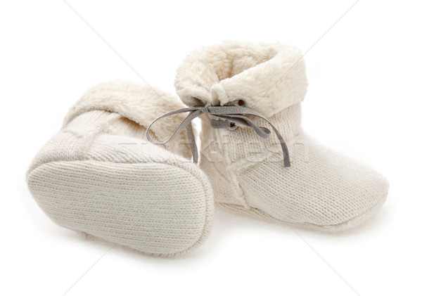 Pair of baby booties over white Stock photo © photobac