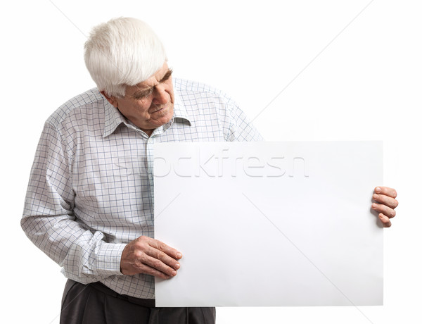 Mature man holding a blank billboard over white Stock photo © photobac