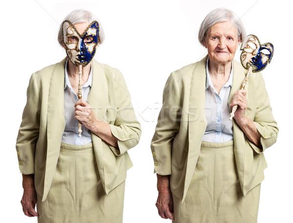 Carnaval máscara em pé branco mão Foto stock © photobac