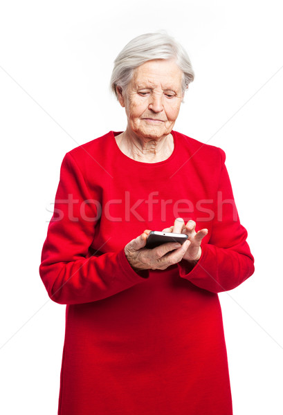 Senior mulher telefone móvel branco em pé moda Foto stock © photobac