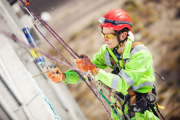 Industrial climber during winterization works Stock photo © photobac