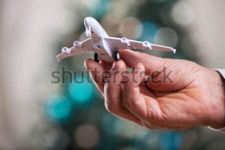 Closeup of man hand holding model of airplane Stock photo © photobac