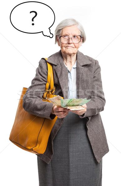 Senior senhora dinheiro balão de pensamento branco mulher Foto stock © photobac