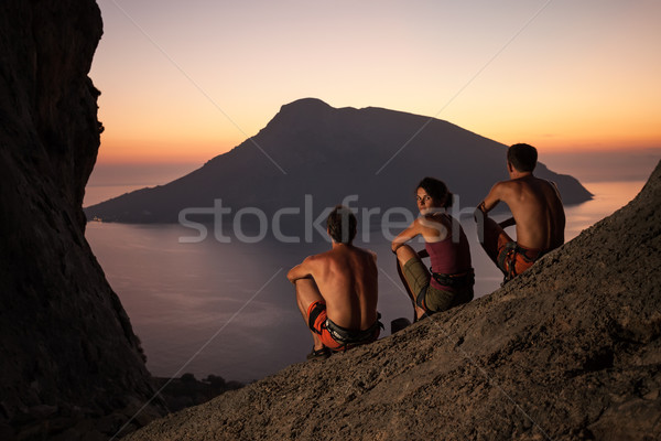 Rock climbers wearing safety harness at sunset Stock photo © photobac