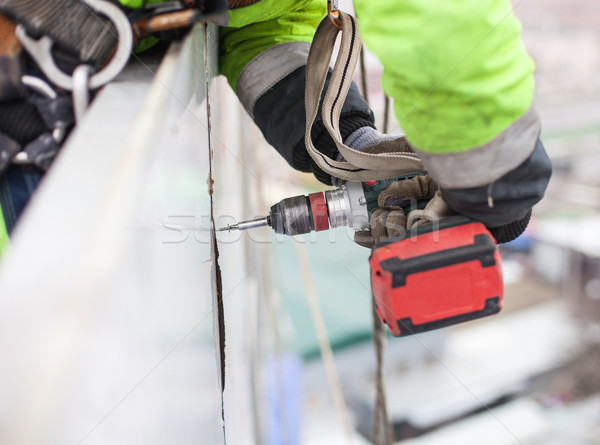 Closeup of industrial climber with screwdriver Stock photo © photobac