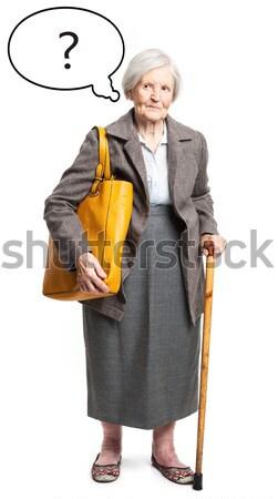 Elegant senior woman with walking stick Stock photo © photobac