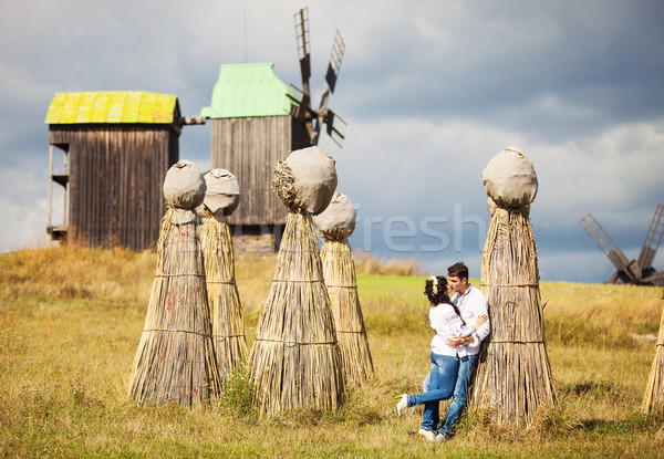 Couple kissing on field with bundles of straw Stock photo © photobac