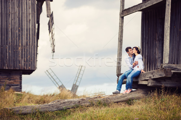 Young couple kissing on steps of old windmill Stock photo © photobac