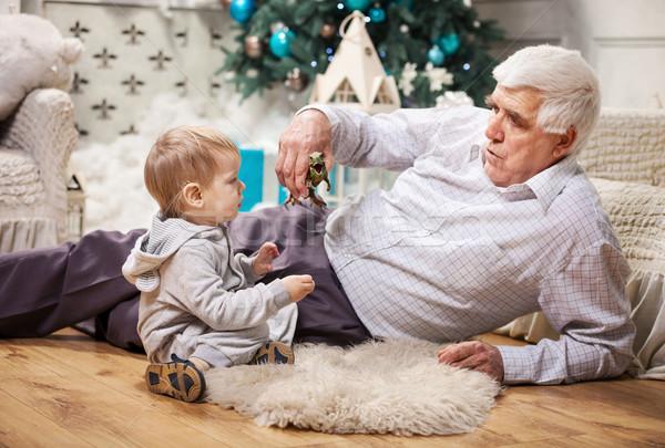 Criança menino avô jogar brinquedo dinossauro Foto stock © photobac