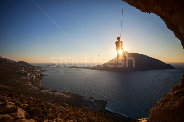 Rock climber hanging on rope while lead climbing Stock photo © photobac