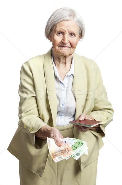 Kıdemli kadın para pasaport yüz Stok fotoğraf © photobac