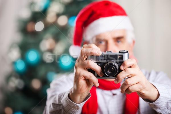 Idős férfi elvesz fotó karácsony kalap Stock fotó © photobac