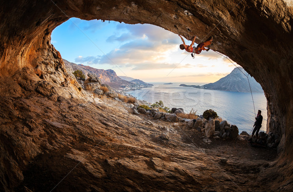 Young woman lead climbing in cave Stock photo © photobac