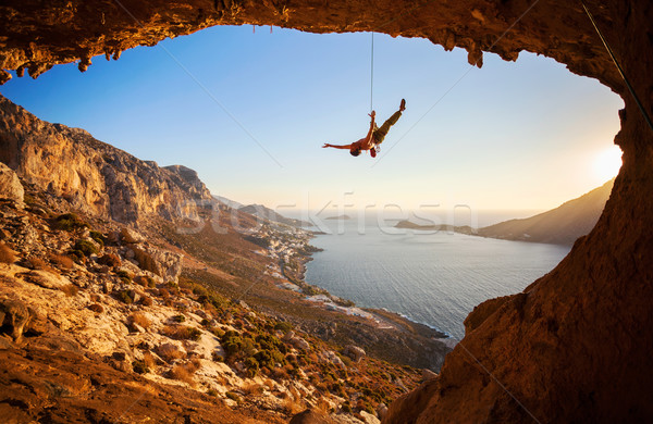 Silhouette of a rock climber falling of a cliff Stock photo © photobac