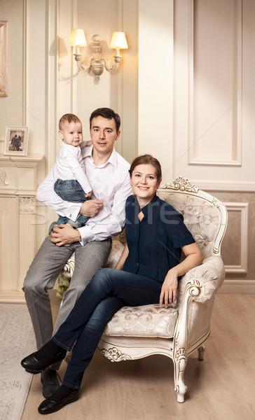 Genç mutlu aile bebek koltuk oturma odası Stok fotoğraf © photobac
