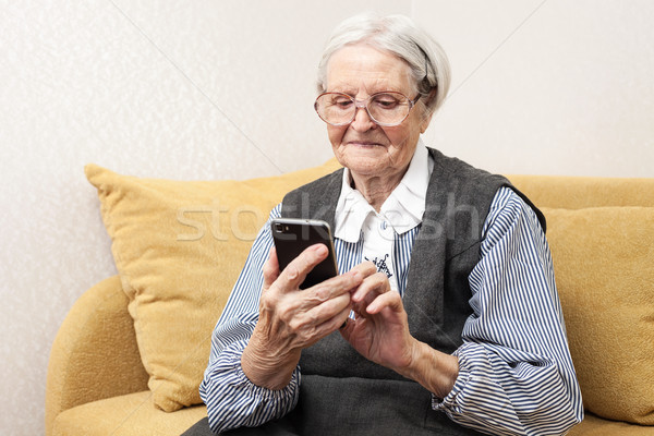 Senior woman using mobile phone Stock photo © photobac