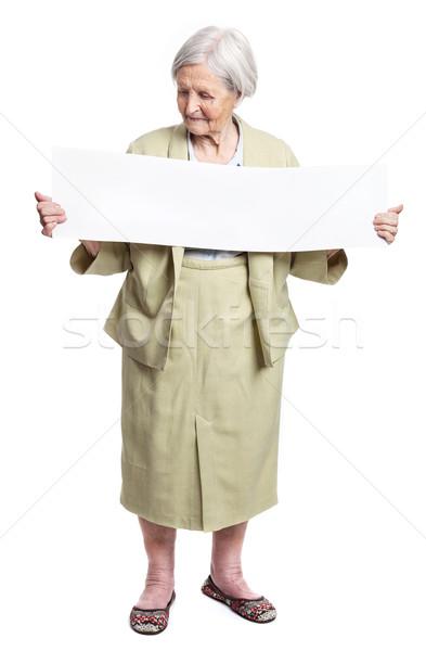 Sorridente idoso senhora folha mãos Foto stock © photobac