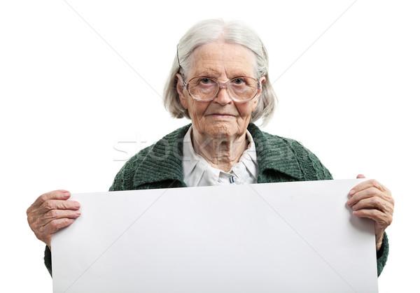Boldog idős hölgy tart lap kéz Stock fotó © photobac