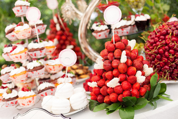 Sweet bar with cupcakes, fresh strawberries Stock photo © photobac