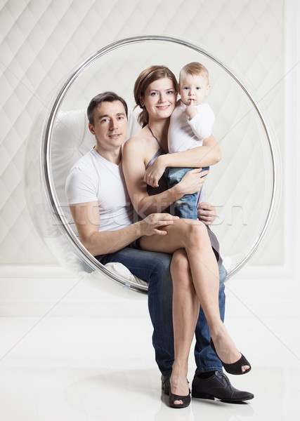Family with baby boy on swinging hanging chair Stock photo © photobac