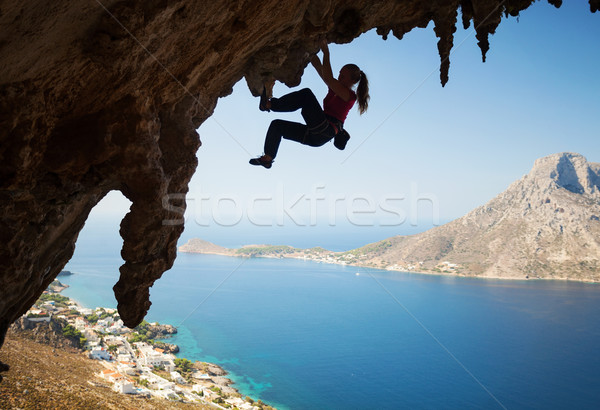 Silhouette of young female rock climber on a cliff Stock photo © photobac
