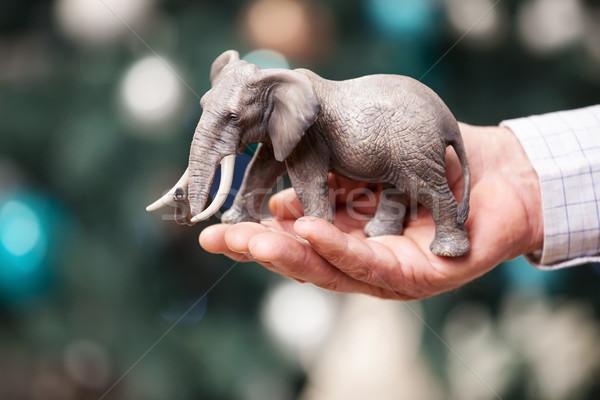 Hand with toy elephant on Christmas background Stock photo © photobac