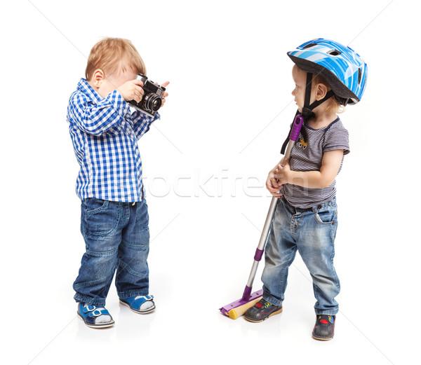 Iki erkek oynama kamera bir Stok fotoğraf © photobac