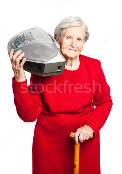 Senior woman while carrying stereo recorder Stock photo © photobac