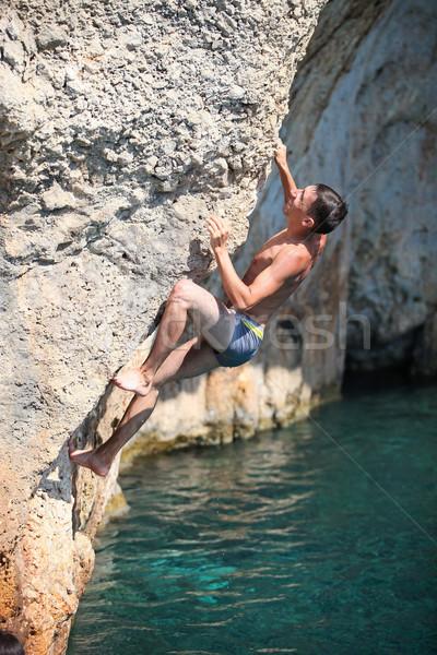 Diep water rock klif mannelijke man Stockfoto © photobac