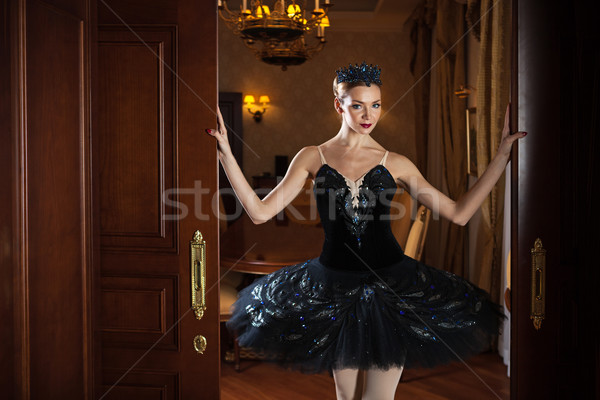 Ballerina in black tutu standing in doorway Stock photo © photobac