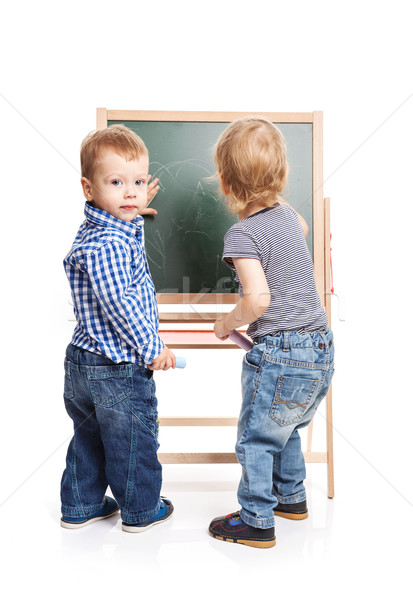 Toddler boys drawing on chalkboard over white Stock photo © photobac