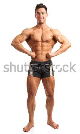 Bodybuilder posing over white background Stock photo © photobac